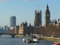 Parliament buildings shining gold in the light of the morning spring sun