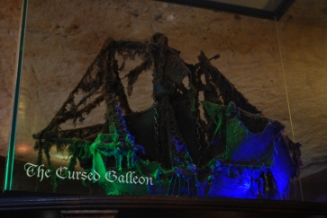 The Cursed Galleon in the Inn, hasn't been cleaned for a long time 'since the last three people who dared to clean it, died very mysterious and totally unexpected deaths.'