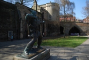 Robin Hod Statue, in the background The Castle Gate House, the only Medieval architecture that left's there