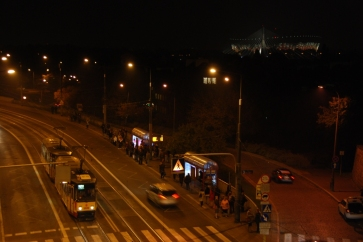 the view from Castle Square over to the East: the beginning of Śląsko-Dąbrowski Bridge, too dark to see the Vistula River and in the top right corner, on the other side of the river - a brand new National Stadium.